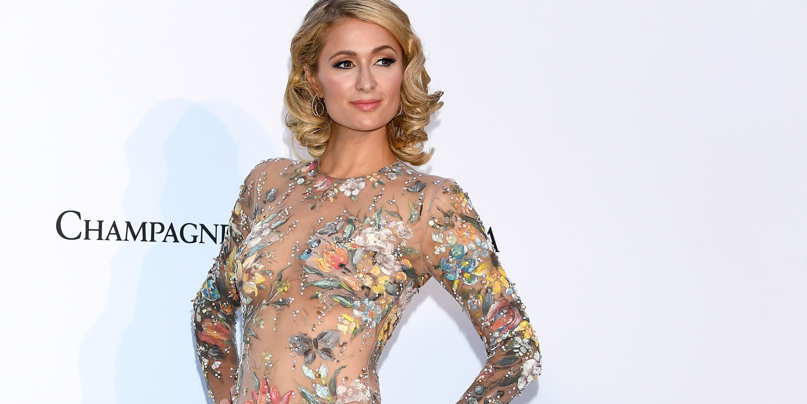 Paris Hilton Wears Naked Floral Dress at Cannes Film Festival