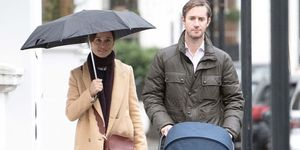 *EXCLUSIVE* Pippa Middleton braves the rain with her husband and newborn son