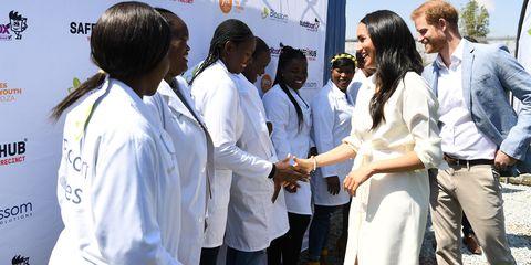 White coat, Uniform, Event, Adaptation, Job, Physician, Team, Gesture, Employment,