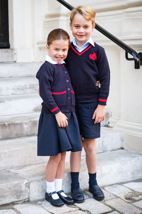 Clothing, Photograph, Uniform, School uniform, Child, Standing, Fashion, Outerwear, Footwear, Child model,