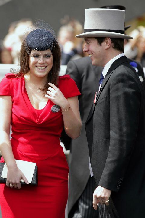 Red, Formal wear, Event, Dress, Fashion, Suit, Headgear, Gesture, Hat, Fashion accessory,