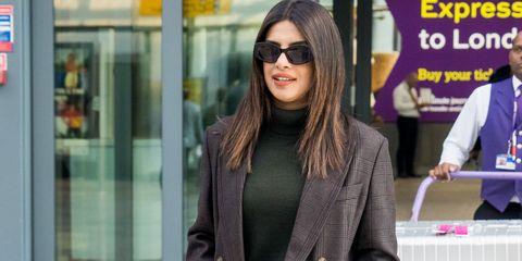 EXCLUSIVE: Priyanka Chopra flies into the UK for the Royal Wedding of Princess Eugenie