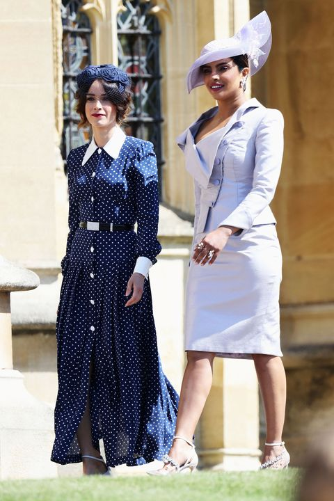 5eac6a9257c0 Priyanka Chopra arrives to the royal wedding ceremony in lavender Vivienne  Westwood.