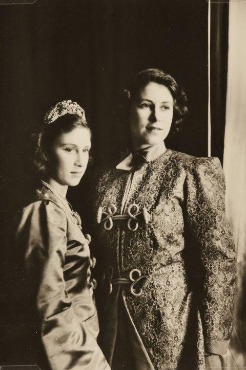 Photograph, Vintage clothing, Retro style, Standing, Classic, Fashion, Headpiece, Headgear, Uniform, Fashion design,