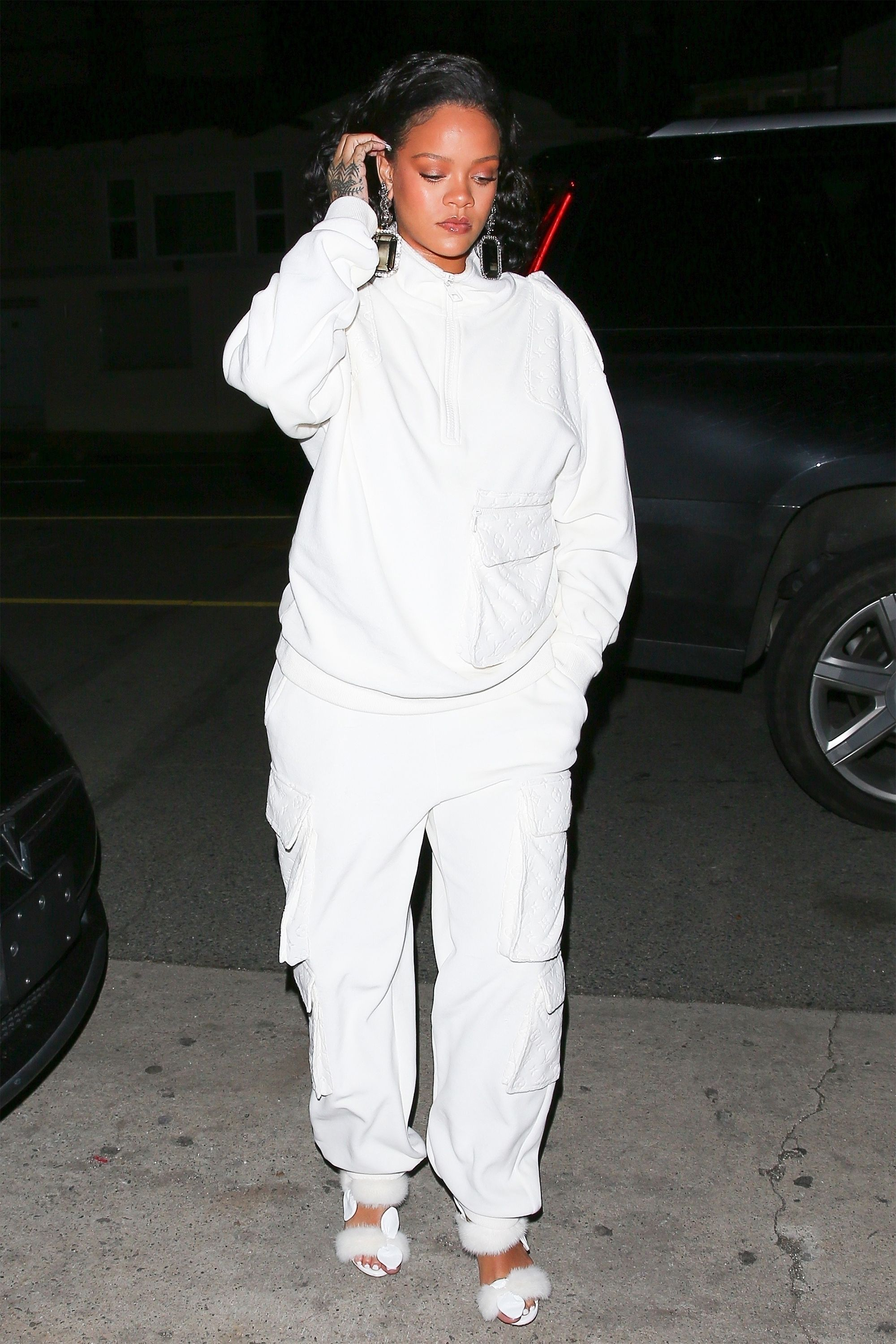 *EXCLUSIVE* Rihanna rocks all white LV as she arrives for dinner at Giorgio Baldi