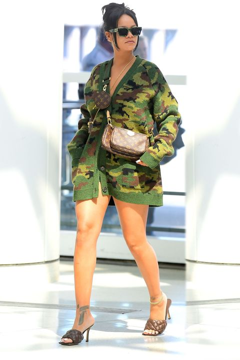 EXCLUSIVE: Rihanna Wears Only A Camo Sweater And Heels As She Catches A Flight To Seoul For Her First Fenty Beauty Masterclass
