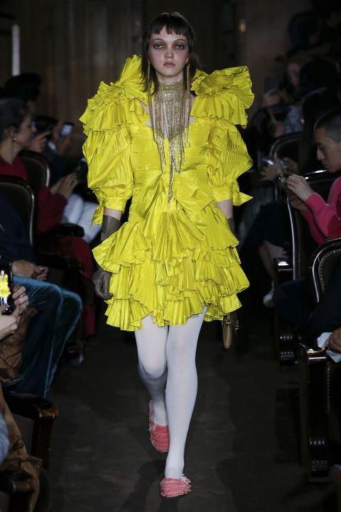 Fashion model, Fashion, Fashion show, Clothing, Runway, Yellow, Fashion design, Haute couture, Footwear, Event,