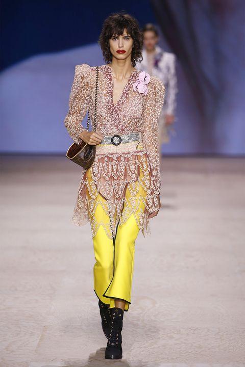 Fashion model, Fashion, Fashion show, Runway, Clothing, Haute couture, Fashion design, Yellow, Public event, Event,