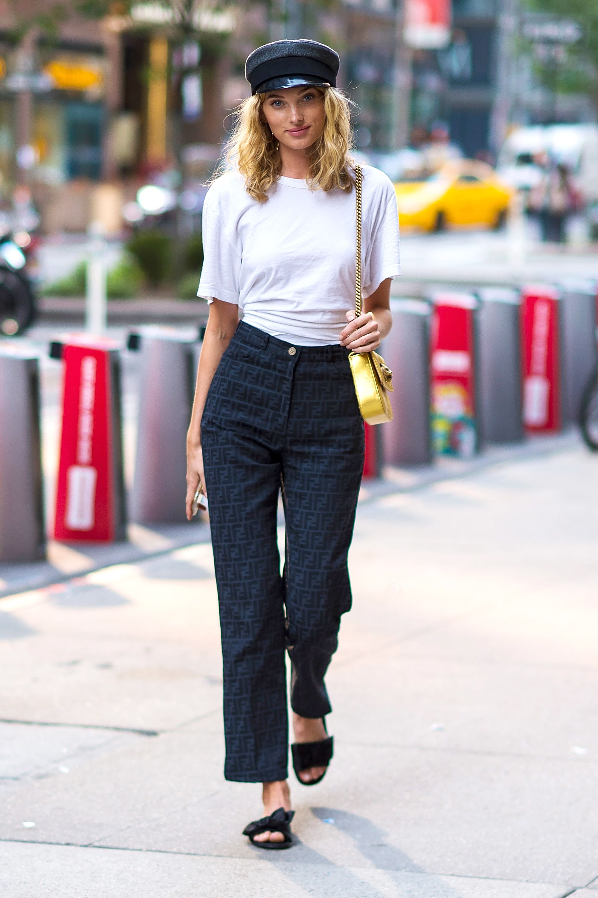 Le Fashion Blog Elsa Hosk Baker Boy Hat White T Shirt High Waist Pants Black Slides Via Harpers Bazaar