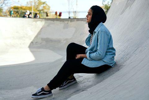 White, Sitting, Black, Street fashion, Jeans, Footwear, Leg, Denim, Outerwear, Photography,