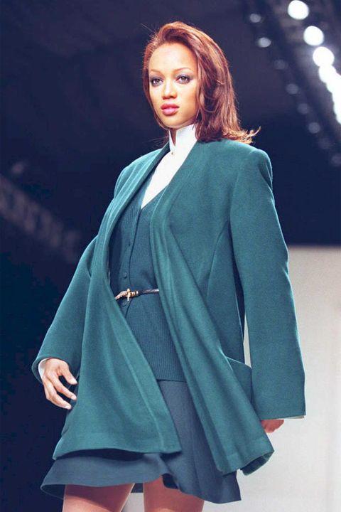 Model Tyra Banks presents a malachite wool wrap co