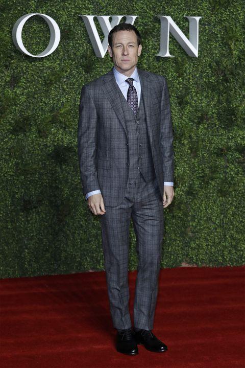 Suit, Red carpet, Formal wear, Clothing, Carpet, Tuxedo, Flooring, Premiere, Pantsuit, Outerwear,