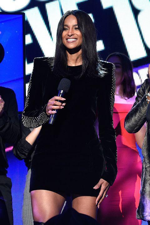 Thigh, Performance, Leg, Fashion, Music artist, Event, Singer, Black hair, Singing, Long hair,