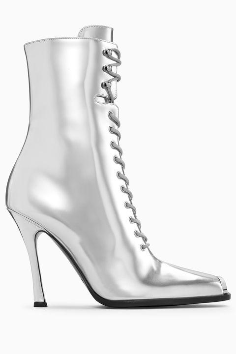 Footwear, High heels, Shoe, Boot, Leg, Sandal, Silver, Metal,