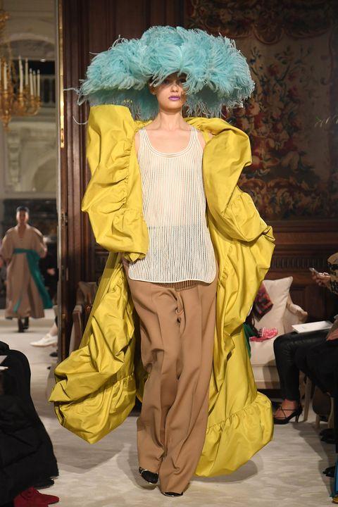 Fashion, Fashion model, Fashion show, Yellow, Runway, Fashion design, Outerwear, Costume design, Event, Haute couture,