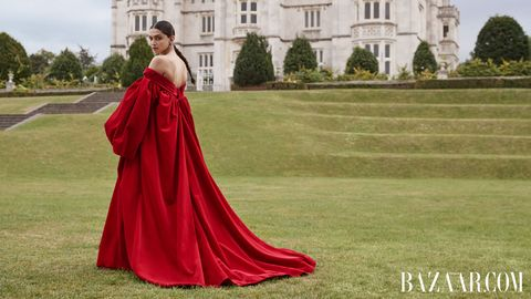 Gown, Dress, Clothing, Red, Shoulder, Formal wear, A-line, Fashion, Fashion model, Haute couture,