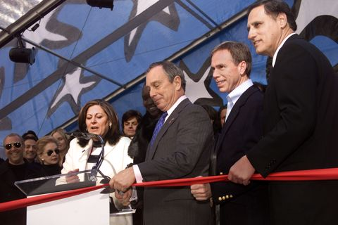 mayor michael bloomberg cutting the ribbon to kick off the mercedes benz fashion week at bryant park in new york city fern mallis, tommy hilfiger and david schembri, vp of marketing for mercedes benz usa look on 282002 photo evan agostiniimagedirec