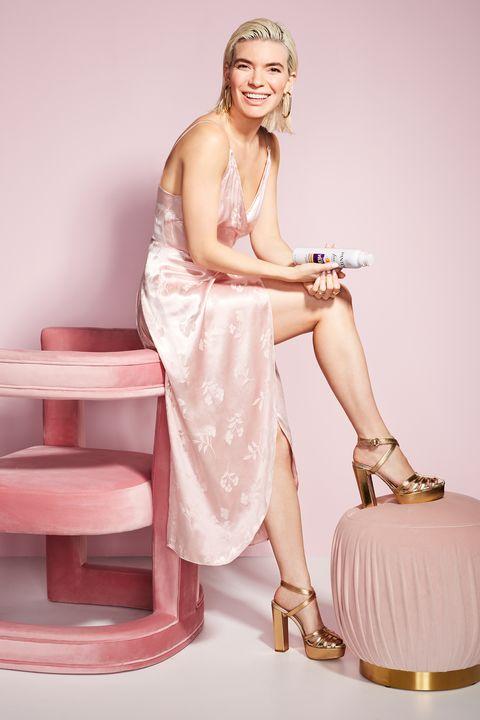 Skin, Beauty, Pink, Blond, Hairstyle, Dress, Leg, Sitting, Photo shoot, Long hair,