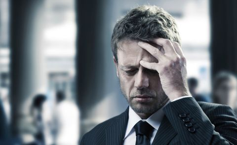 man in suit with a headache