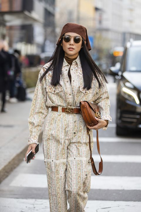 paris, france   march 03 digital influencer julia comil wears a nanushka jumpsuit, victoria beckham shirt, longchamp hair scarf on march 03, 2020 in paris, france photo by kirstin sinclairgetty images