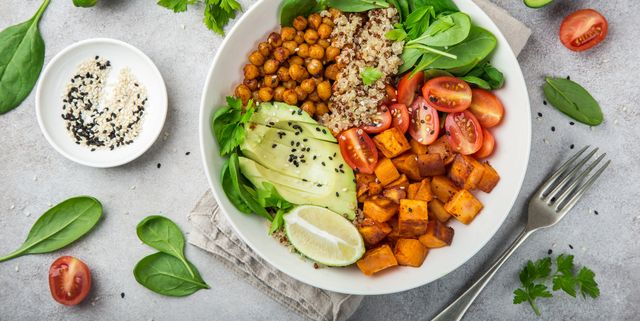 healhty vegan lunch bowl avocado, quinoa, sweet potato, tomato, spinach and chickpeas vegetables salad