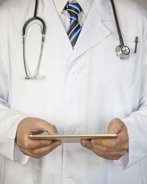 Healthcare And Medicine. Doctor using a digital tablet. Medical concept
