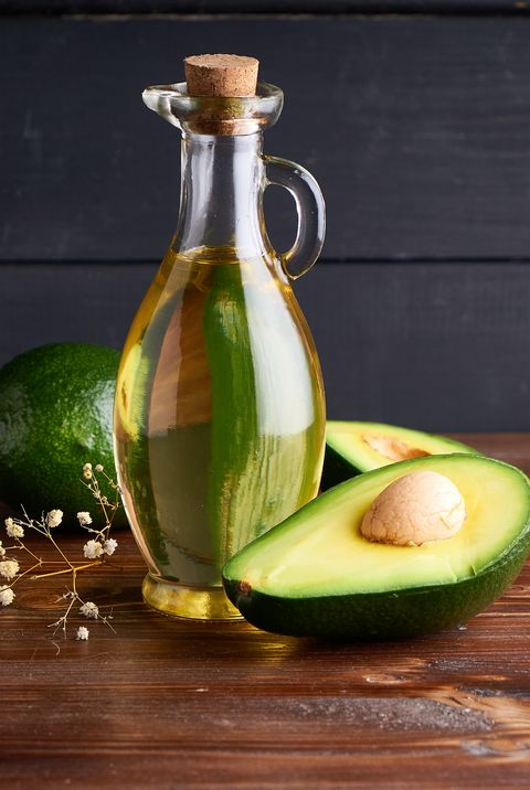 healthy avocado oil in glass bottles dark background copy space