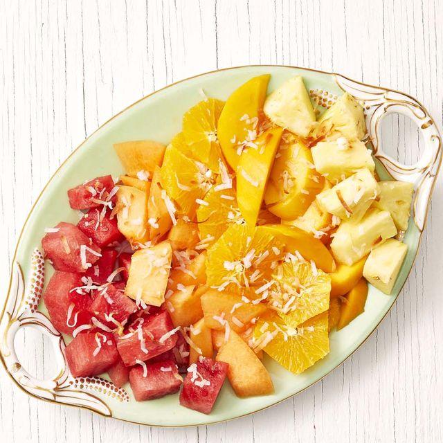 sunrise fruit salad on white wood background