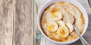 Healthy breakfast, oatmeal porridge with banana with text copy space