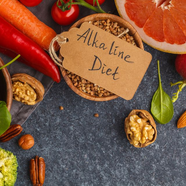 Healthy food background, trendy Alkaline diet products - fruits, vegetables, nuts, dark background, copy space