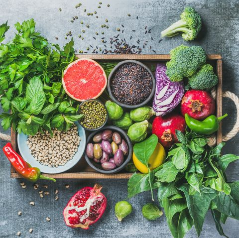 Healthy food ingredients in wooden box over grey background