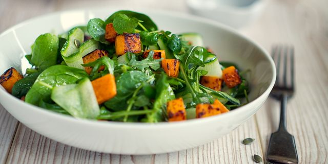 healthy green salad with roasted butternuts squash