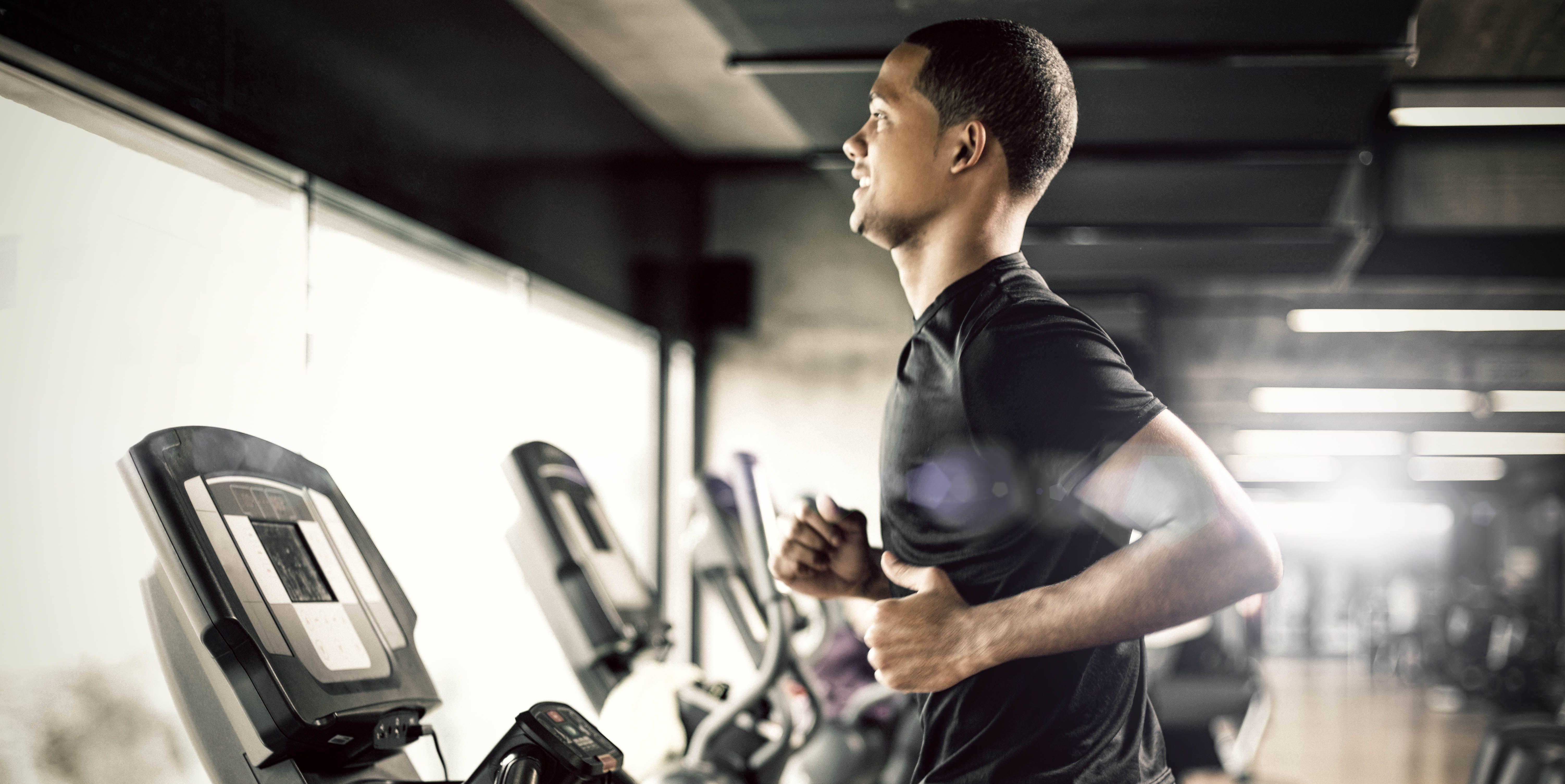Healthy man Running on Treadmill