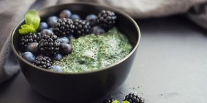 Healthy organic spirulina porridge topped with berries