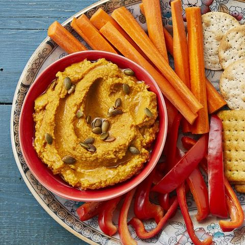 roasted garlic pumpkin hummus with peppers and carrots
