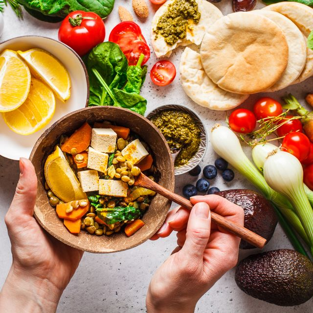 healthy vegetarian food background vegetables, pesto and lentil curry with tofu