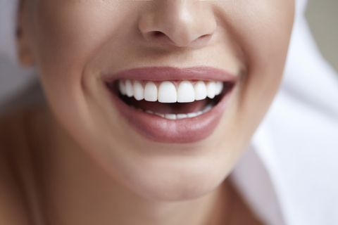 healthy white smile close up beauty woman with perfect smile, lips and teeth beautiful model girl with perfect skin teeth whitening