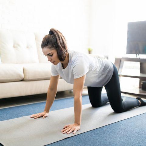 healthy woman exercising at home
