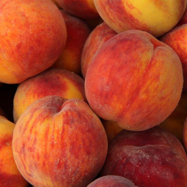 a heap of ripe peaches prunus persica close up