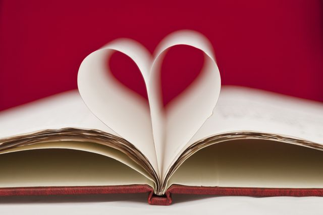 heart made with the leaves of a book
