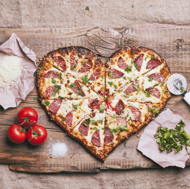 heart shaped foods  heart shaped pizza and ingredients on cutting board