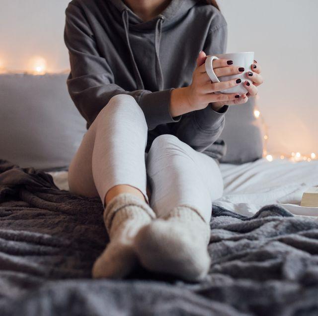 woman in loungewear sitting on blanket