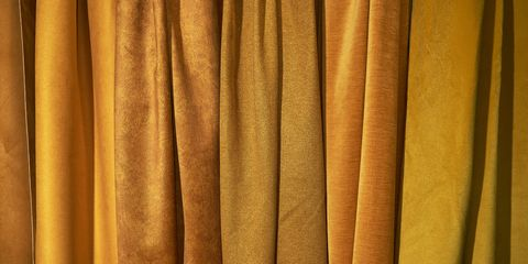 dense textile and boucle textile which are golden in color background, texture