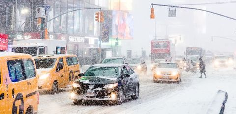 Heavy snow seen falling at Times Square.    New York city is...
