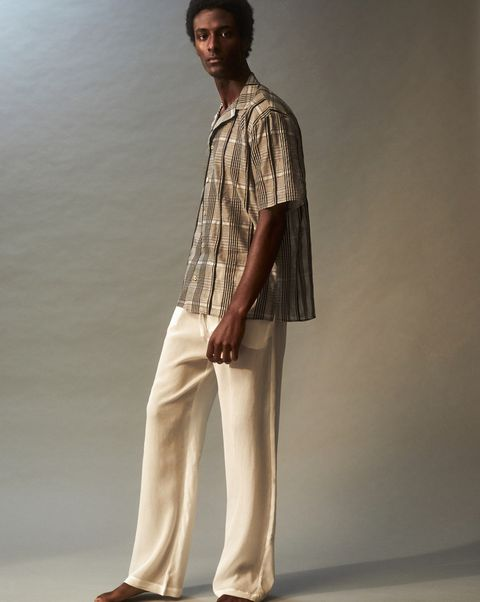 Clothing, Fashion, Fashion model, Standing, Shoulder, Beige, Neck, Formal wear, Fashion design, Sleeve,