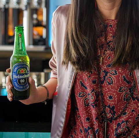 Drink, Alcohol, Liqueur, Beer, Alcoholic beverage, Distilled beverage, Soft drink, Carbonated soft drinks, Neck, Dress,