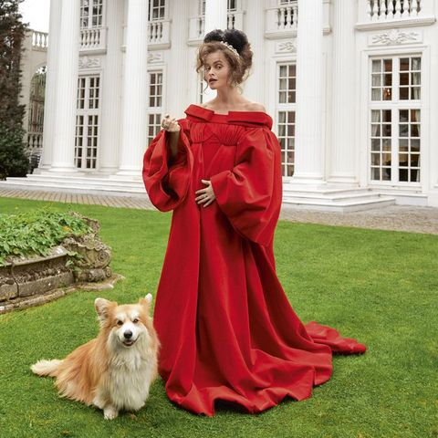 Red, Dress, Canidae, Companion dog, Gown, Outerwear, Architecture, Formal wear, Mansion, Fawn,