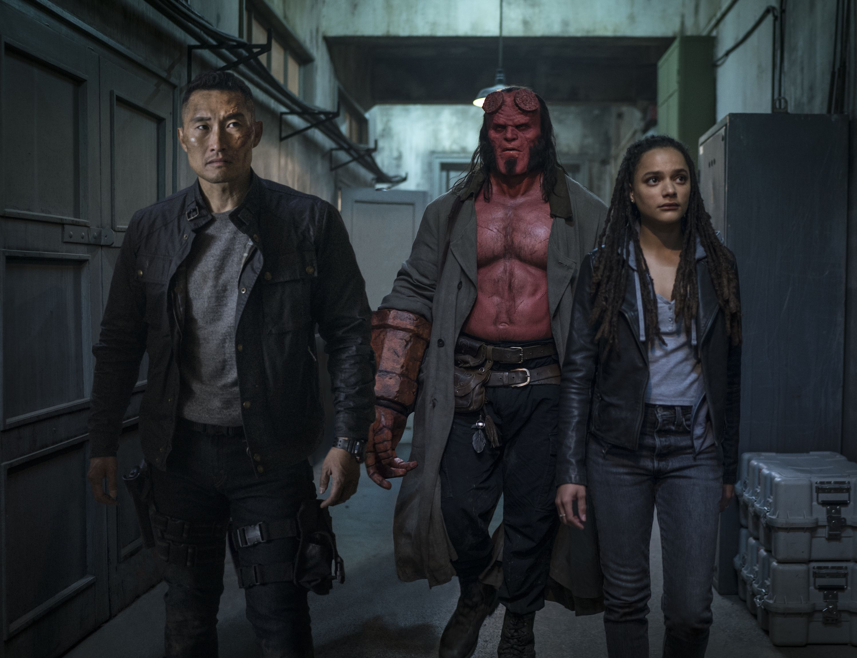 Daniel Dae Kim (Ben Daimio), David Harbour (Hellboy), and Sasha Lane (Alice Monaghan)