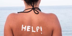 Help written with Sun Cream on a Woman's Shoulder