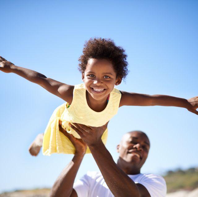 helping his daughter soar